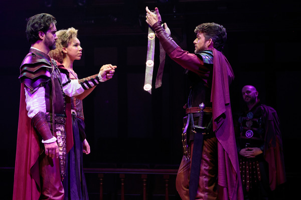 Lepidus (Robbie Gay) leads the wedding ceremony between Mark Antony (Cody Nickell) and Octavia (Nicole King), bringing peace to the leaders of Rome, with Agrippa (Chris Genebach) looking on.
