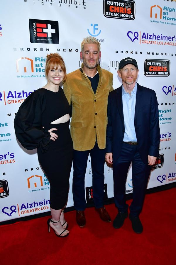 "Pictured (L-R) Bryce Dallas Howard, Ron Howard, and ALZGLA VP Kara Bonela last evening at the Broken Memories premiere starring Rance Howard. Bonela presented the Howard family with a framed photo of Rance and Judy Howard from ALZGLA's ""Let's Face It Toge"