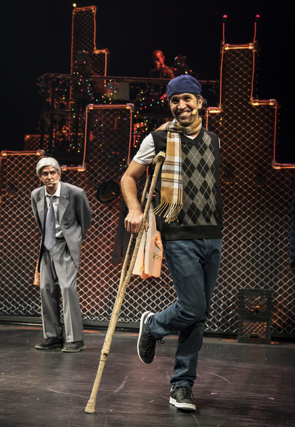 "Lil' Tim (JQ, at center) charms with his classic refrain �""God bless us err'body"" while Scrooge (GQ) looks on in Chicago Shakespeare Theater's production of Q Brothers Christmas Carol, presented in The Yard at Chicago Shakespeare, November 21–D"