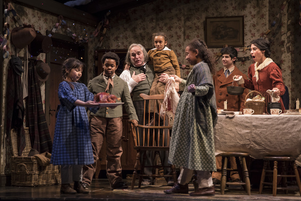 Maggie Chong (Emily Cratchit), Kei (Kei Cratchit), Ron E. Rains (Bob Cratchit), Paris Strickland (Tiny Tim), Andrea Crisp (Belinda Cratchit), Aaron Stone (Peter Cratchit) and Michele Vasquez (Mrs. Cratchit)