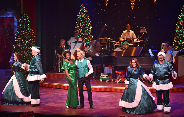 "Backed by the Beef & Boards Orchestra, Renée Jackson and Kenny Shepard (center) join the Beef & Boards Quartet (from left) Marisa Rivera, Peter Scharbrough, Betsy Norton and Kyle Durbin in a rousing rendition of ""Rocking Around The Christmas Tree� in"