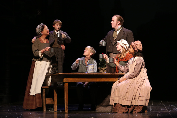 Amy McWilliams as Mrs. Cratchit, Malcom Fuller as Tiny Tim, Tad Clifton as Peter Crat Photo