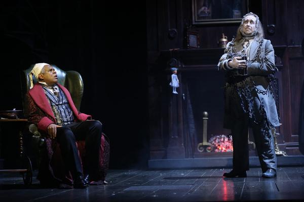 Craig Wallace as Ebenezer Scrooge and James Konicek as Jacob Marley Photo