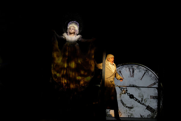 Erin Mueller as the Ghost of Christmas Past and Steve Hendrickson as Scrooge Photo