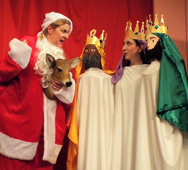"""Susan Fowler (left) and Allison Deratzian (right) perform a holiday sketch as part of the second act of the ActorsNET regional premiere of Bo Wilson's new holiday comedy, The Charitable Sisterhood Christmas Spectacular.  Ms. Fowler brought a �""""deer fr"""