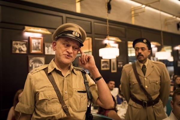 Harmage Singh Kalirai as the Inspector and Raj Aich as Romesh