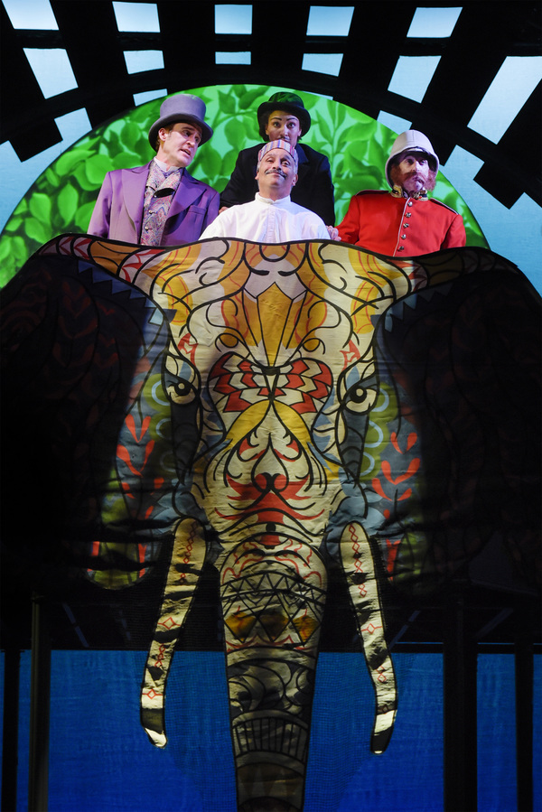 Parsi (Michael Gene Sullivan, center) and his elephant give a lift to (L-R) Phileas Fogg (Jason Kuykendall), Passepartout (Tristan Cunningham), and Sir Francis (Ron Campbell) in TheatreWorks Silicon Valley's Around the World in 80 Days. The hilarious holi