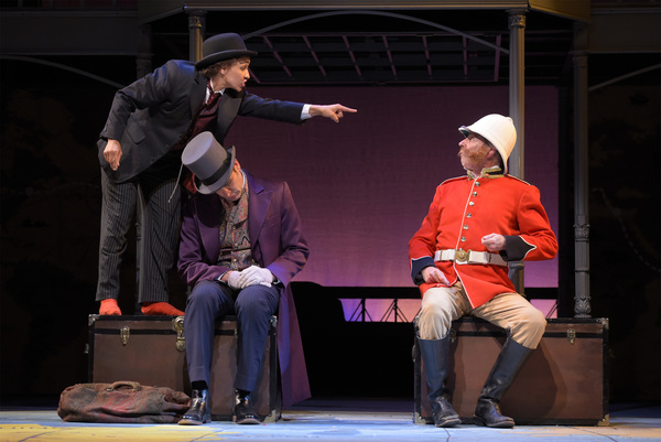 L-R: Passepartout (Tristan Cunningham) stands up to Sir Francis (Ron Campbell) while Phileas Fogg sleeps (Jason Kuykendall, center) in TheatreWorks Silicon Valley's Around the World in 80 Days. The hilarious holiday adventure adapted by Mark Brown from th