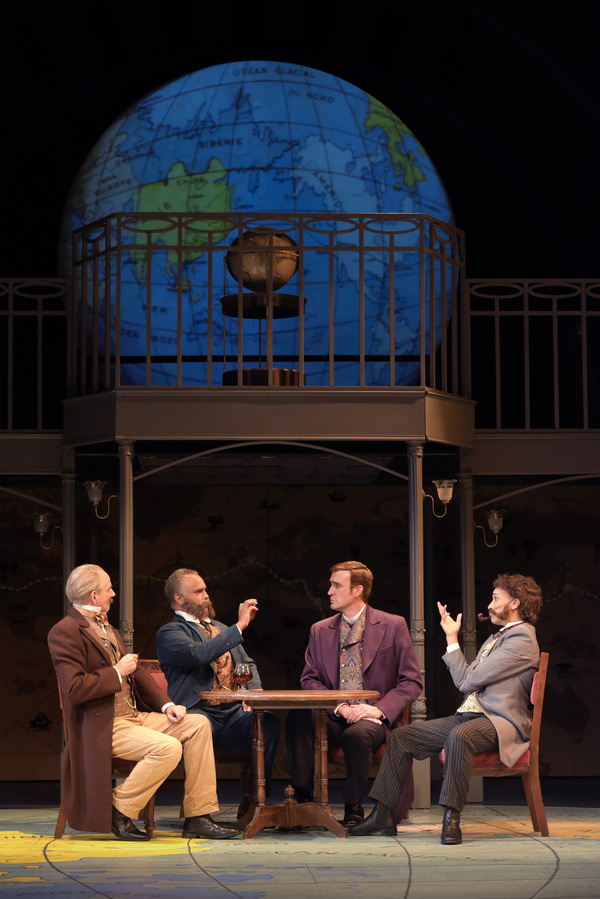 Phileas Fogg (right center, Jason Kuykendall) bets he can circumnavigate the globe to fellow members of the Reform Club (L-R: Ron Campbell, Michael Gene Sullivan, and Tristan Cunningham) in TheatreWorks Silicon Valley's Around the World in 80 Days. The hi