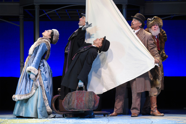 "L-R: Aouda (Ajna Jai), Phileas Fogg (Jason Kuykendall), Passepartout (Tristan Cunningham), Detective Fix (Michael Gene Sullivan), and Mudge (Ron Campbell) cross America's frozen Great Plains on a sail-sled ""sledge"" in TheatreWorks Silicon Valley's Around"