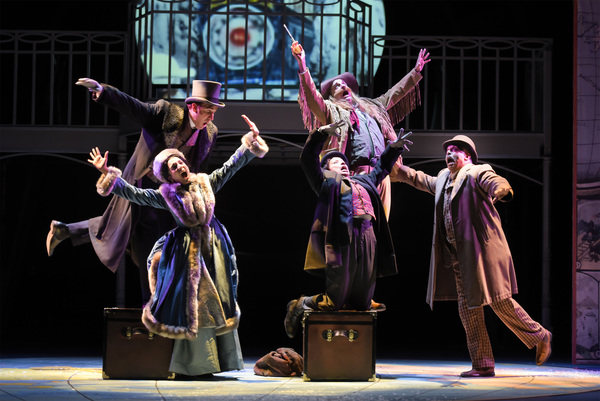 Clockwise L-R: Phileas Fogg (Jason Kuykendall), Colonel Proctor (top center, Ron Campbell), Detective Fix (Michael Gene Sullivan), Passepartout (Tristan Cunningham) and Aouda (Ajna Jai) get thrown about in a runaway train during their travels in TheatreWo