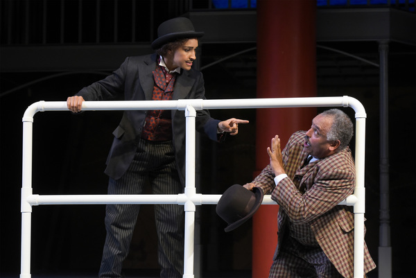 L-R: Passepartout (Tristan Cunningham) challenges Detective Fix (Michael Gene Sullivan) in TheatreWorks Silicon Valley's Around the World in 80 Days. The hilarious holiday adventure adapted by Mark Brown from the novel by Jules Verne plays at the Lucie St