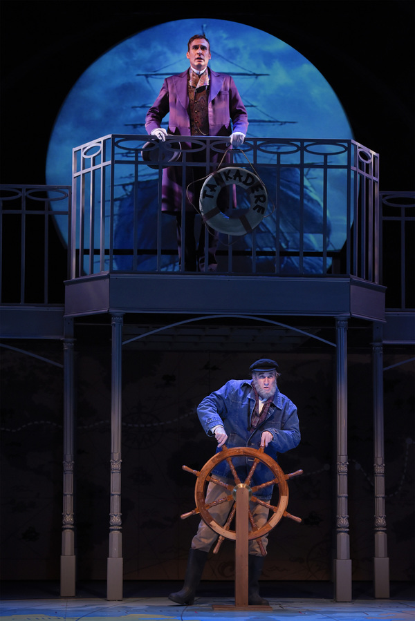 L-R: Phileas Fogg (top, Jason Kuykendall) travels from Hong Kong to Yokohama aboard a ship captained by Bunsby (Ron Campbell) in TheatreWorks Silicon Valley's Around the World in 80 Days. The hilarious holiday adventure adapted by Mark Brown from the nove
