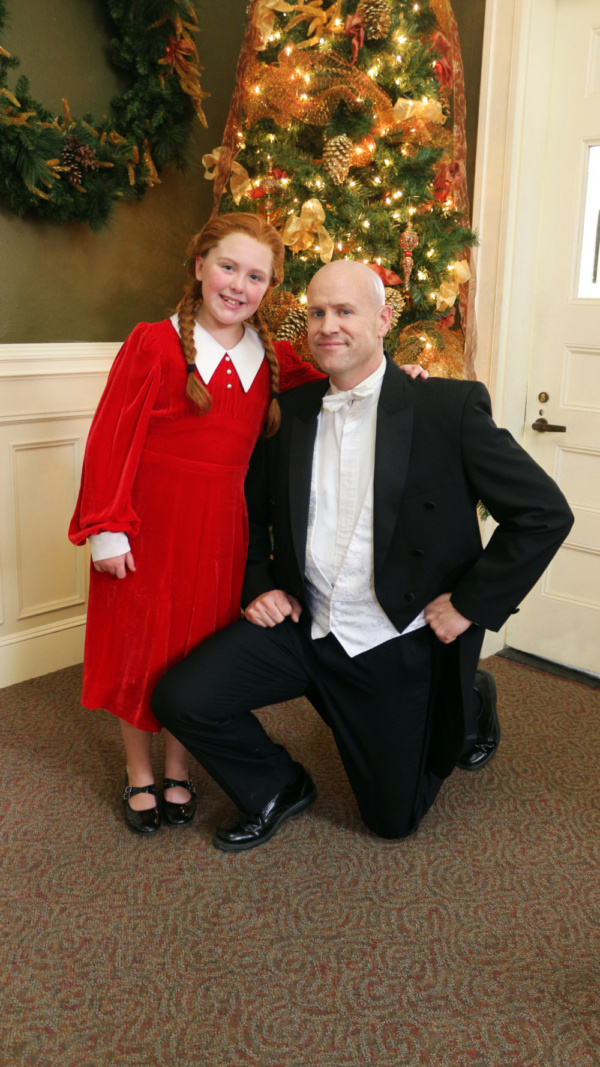 Annie (Evelyn LaCroix) and Oliver Warbucks (Chad Boothman) from Annie the Musical at the Waterville Opera House