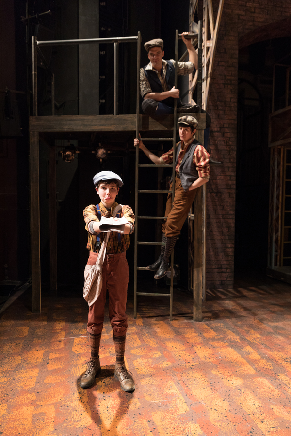 Brandon Smith as Les, in front of Jonathan Shew as Jack Kelly and Stephen Michael Langton as Davey
