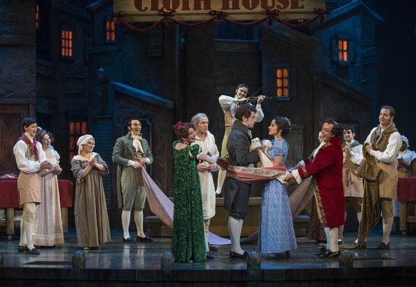 Milwaukee Repertory Theater presents A Christmas Carol in the Historic Pabst Theater from November 28 to December 24, 2017. Left to Right: Angela Iannone, Jonathan Wainwright, Christopher Peltier, Arya Daire, Michael J. Farina with the ensemble of A Chris