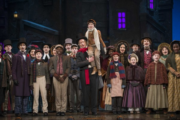 Milwaukee Repertory Theater presents A Christmas Carol in the Historic Pabst Theater from November 28 to December 24, 2017. Left to Right: Jonathan Wainwright and Ashley Bock with the company of A Christmas Carol. Photo by Michael Brosilow.