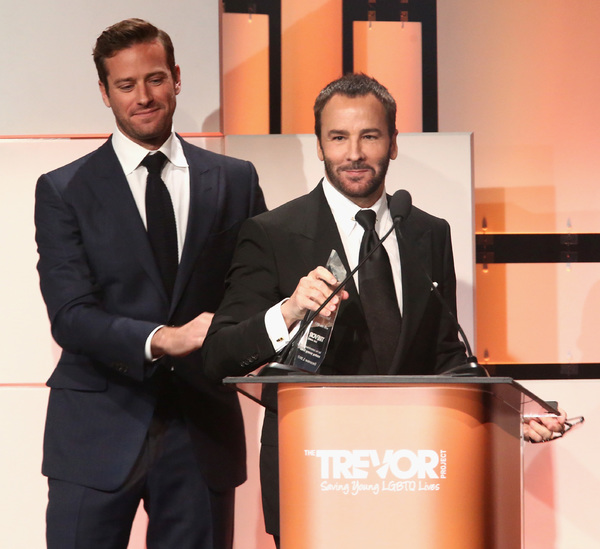 Honoree Tom Ford accepts the Hero Award from Armie Hammer