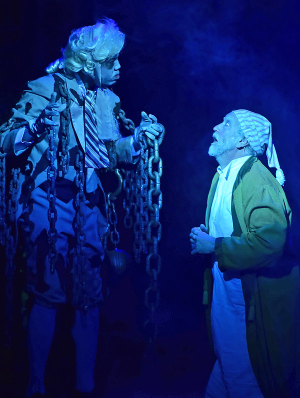 The ghost of his business partner Jacob Marley (Joshua L.K. Patterson) visits Ebenezer Scrooge (Jeff Stockberger) on the night of Christmas Eve