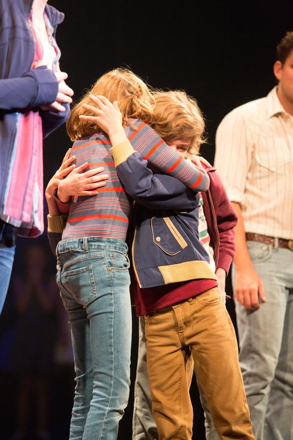 The Fun Home kids embrace (Carly Gold, Henry Boshart & Luké Barbato Smith)