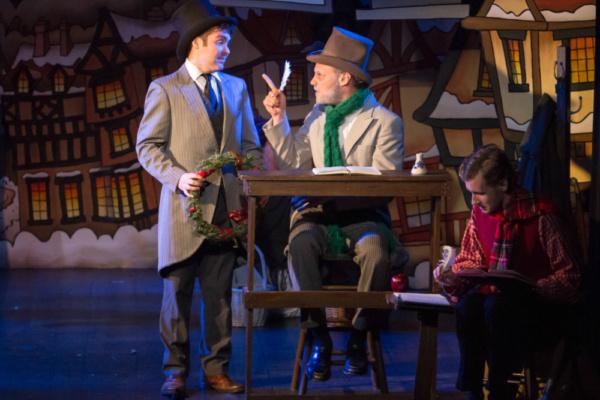 Scrooge (Eric Fletcher) and Nephew Fred (Matthew Petromilli)  Photo by Martin Harris
