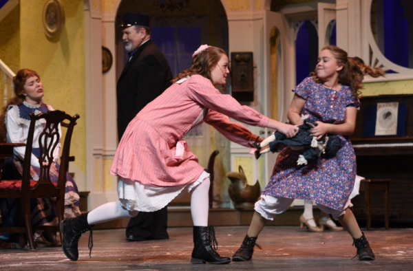 Agnes (Abby Knight) and Tootie (Wynter Osstifin) tussle over a doll in Meet Me in St. Louis at the Croswell Opera House in Adrian.