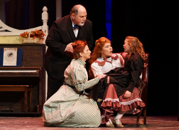 Grandpa (George Reasoner), Anna (Alisa Mutchler Bauer), and Esther (Sarah Hodgman) tend to an injured Tootie (Wynter Osstifin) in a scene from Meet Me in St. Louis.