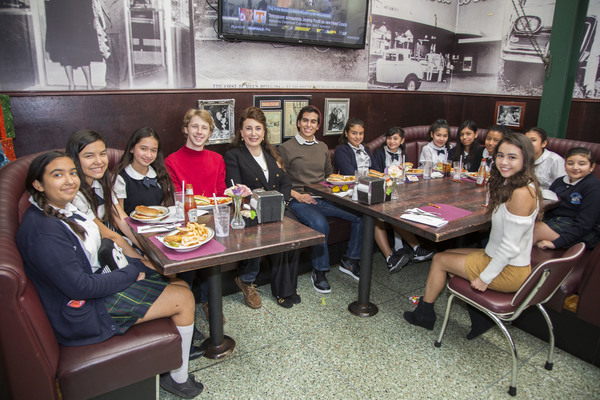 Amber Romero (right), Joey Luthman and James Calvo join Donelle Dadigan (center) and Dolores Mission students in corner booth at Mel's Diner
