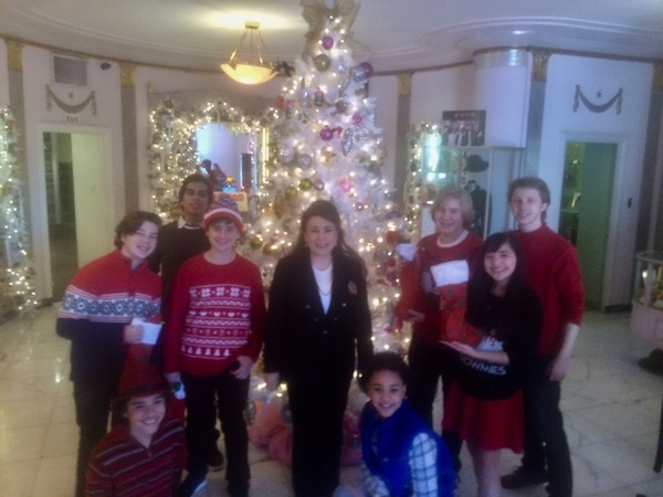 President and Founder of The Hollywood Museum, Donelle Dadigan, surrounded by child performers, Landon Gimenez, Hunter Payton, Jax Malcolm, Ciara Wilson, Conner Dean, Chloe Noelle and Joey Luthman pose with Christmas tree in the museum lobby.