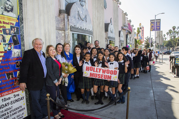 Dolores Missions students line up out side the Hollywood Museum for holiday tour, hosted by Museum President and Founder, Donelle Dadigan (5th from left)