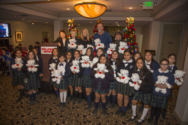 Donelle Dadigan, Erin Murphy, Darby Hinton and Dawn Wells help Dee Wallace (Second from left, top row) hand out her BuppaLaPaloo Bears, designed to help with selfesteem, to the 6th graders