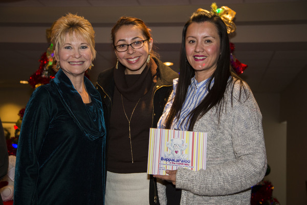"Dee Wallace presents copies of her ""BuppaLaPaloo & the I Love Me's"" book to Dolores Mission principles Melissa and Corina for all of the 1st and 2nd graders."