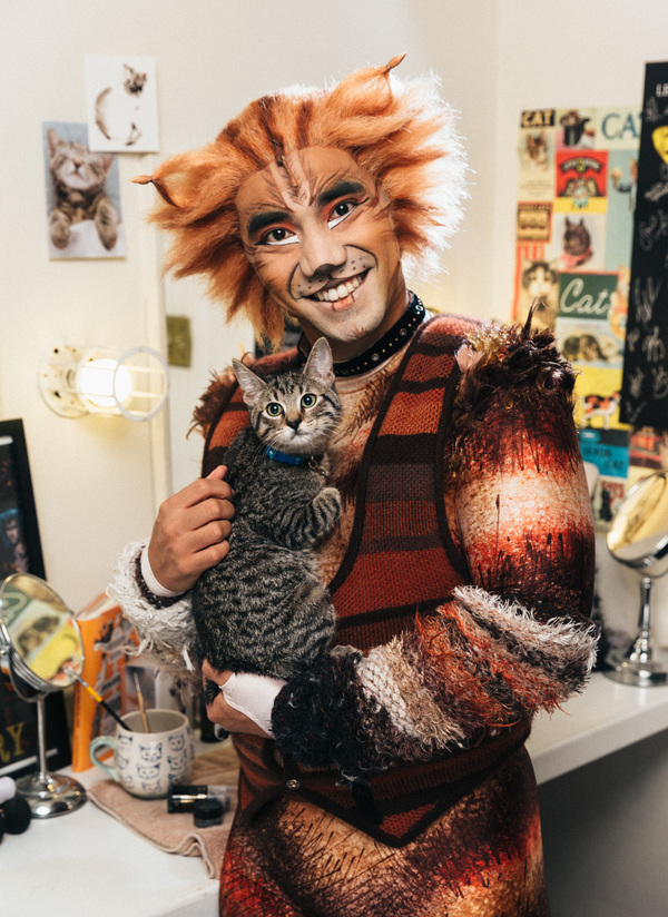 Aaron J. Albano of the CATS cast and an adoptable shelter kitten from The Humane Society of New York