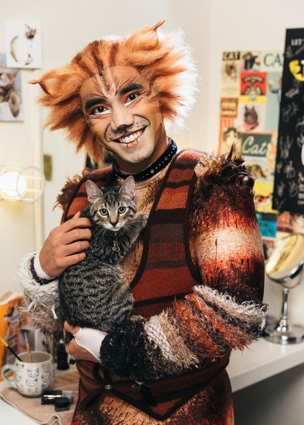 Aaron J. Albano of the CATS cast and an adoptable shelter kitten from The Humane Soci Photo