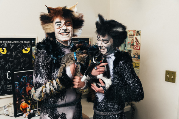 Joshua Michael Burrage and Robbie Nicholson of the CATS cast spend time with adoptabl Photo