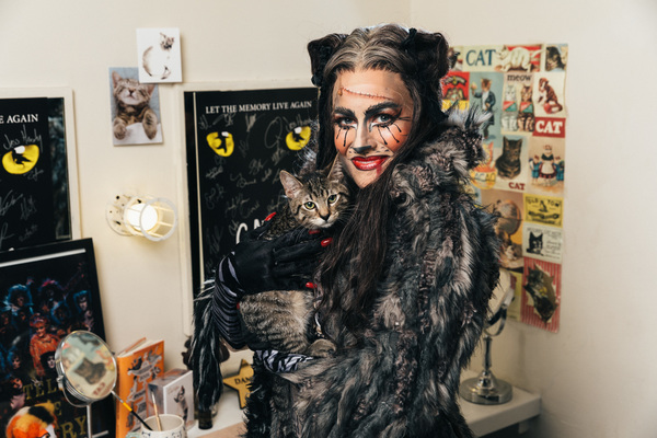 Mamie Parris of the CATS cast and an adoptable shelter cat share a moment backstage