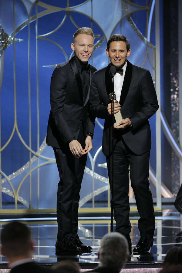 """75th ANNUAL GOLDEN GLOBE AWARDS -- Pictured: (l-r) Justin Paul, Benj Pasek accept the award for Best Original Song – Motion Picture for Â""""This Is Me,Â"""" The Greatest Showman at the 75th Annual Golden Globe Awards held at the Beverly Hilton Hotel on Januar"""