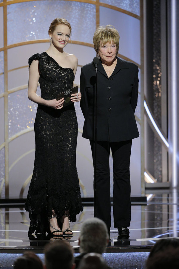 75th ANNUAL GOLDEN GLOBE AWARDS -- Pictured: (l-r) Emma Stone, Shirley MacLaine, Presenters at the 75th Annual Golden Globe Awards held at the Beverly Hilton Hotel on January 7, 2018 -- (Photo by: Paul Drinkwater/NBC)