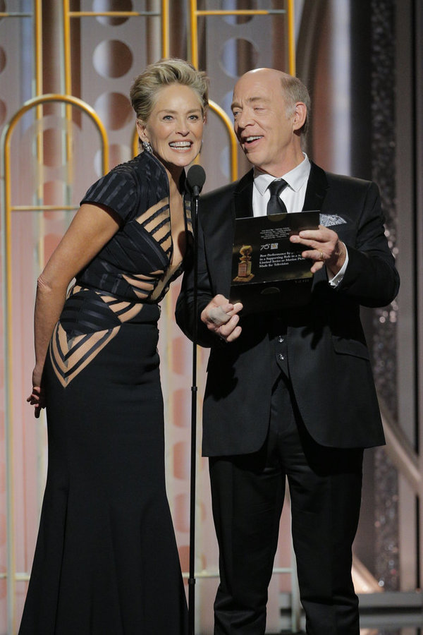 75th ANNUAL GOLDEN GLOBE AWARDS -- Pictured: (l-r) Sharon Stone, J.K. Simmons, Presenters at the 75th Annual Golden Globe Awards held at the Beverly Hilton Hotel on January 7, 2018 -- (Photo by: Paul Drinkwater/NBC)