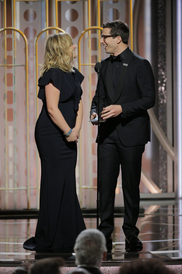75th ANNUAL GOLDEN GLOBE AWARDS -- Pictured: (l-r) Amy Poelher, Andy Samberg, Presenters at the 75th Annual Golden Globe Awards held at the Beverly Hilton Hotel on January 7, 2018 -- (Photo by: Paul Drinkwater/NBC)