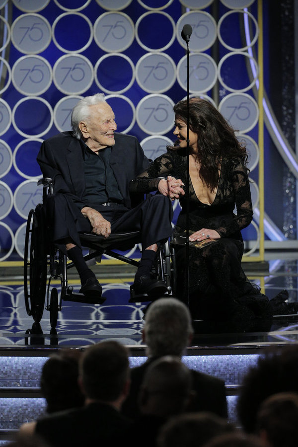 75th ANNUAL GOLDEN GLOBE AWARDS -- Pictured: (l-r) Kirk Douglas, Catherine Zeta Jones, Presenters at the 75th Annual Golden Globe Awards held at the Beverly Hilton Hotel on January 7, 2018 -- (Photo by: Paul Drinkwater/NBC)