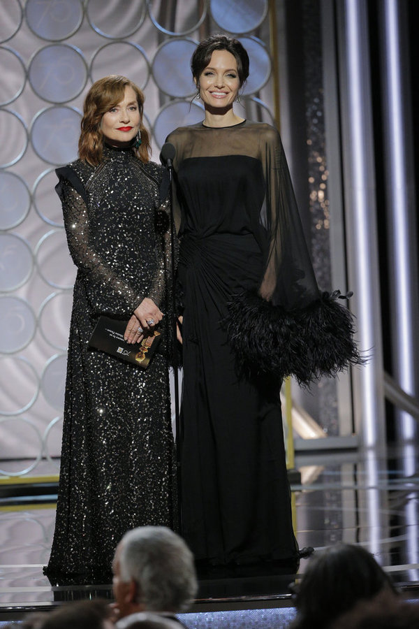 75th ANNUAL GOLDEN GLOBE AWARDS -- Pictured: (l-r) Isabelle Huppert, Angelina Jolie, Presenters at the 75th Annual Golden Globe Awards held at the Beverly Hilton Hotel on January 7, 2018 -- (Photo by: Paul Drinkwater/NBC)