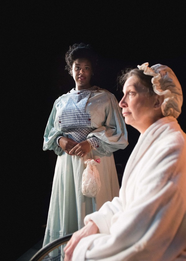 Seeking guidance, Emily Wilding Davison (Taylor Raye) visits a recuperating Emmeline Pankhurst (Jean Marie Koon) in Babes With Blades Theatre Company's THE GOOD FIGHT