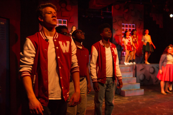 left to right: Nick Brogan, Raj Ukondwa, Bryan Thompson, and John Woods III and the ensemble of HEATHERS THE MUSICAL: High School Edition. Photo courtesy of Bruce F Press Photography.