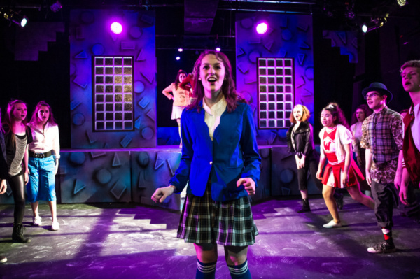 Leah Reineck (center) as Veronica Sawyer with the ensemble of HEATHERS THE MUSICAL: High School Edition. Photo courtesy of Bruce F Press Photography.