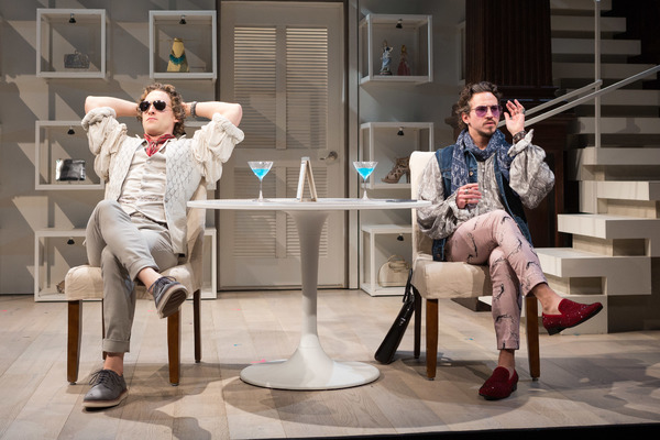 Henry (Luigi Sottile) and friend Charles (Brandon Espinoza, right) enjoy a cocktail and the Hamptons' sun in Theresa Rebeck's The Way of the World.