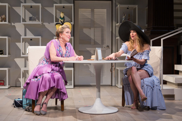 Aunt Rene (Kristine Nielsen, left) tries her best to cheer up Mae (Eliza Huberth) at a Hamptons bistro in Theresa Rebeck's The Way of the World. On stage at Folger Theatre