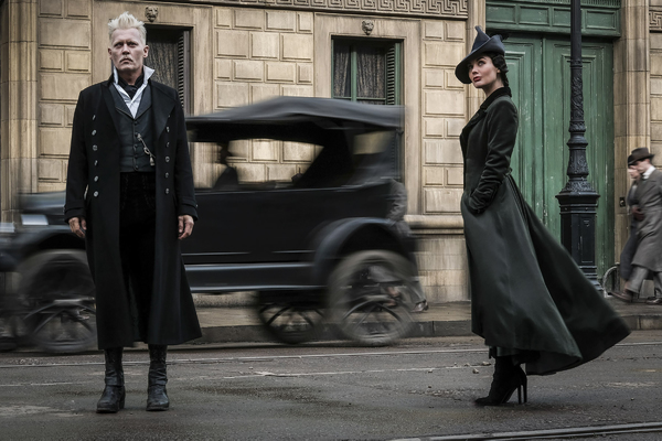 "(L-R) JOHNNY DEPP as Gellert Grindelwald and POPPY CORBY-TUECH as Vinda Rosier, one of Grindelwald's most trusted followers, a loyal servant to his cause and often at his side, in Warner Bros. Pictures' fantasy adventure ""FANTASTIC BEASTS: THE CRIMES OF"