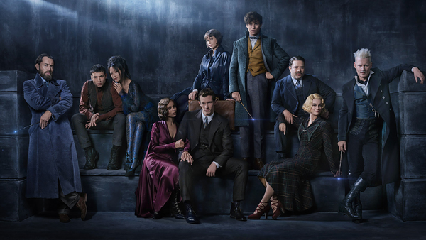 Left to right) JUDE LAW plays a young ALBUS DUMBLEDORE, taking on the mantle of one of J.K. Rowling's most beloved characters; EZRA MILLER makes a return as the enigmatic CREDENCE, whose fate was unknown at the end of the first film; CLAUDIA KIM appears