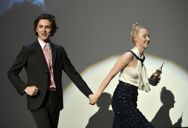 Actors Timothee Chalamet and Saoirse Ronan onstage at the Santa Barbara Award Honoring Saoirse Ronan Presented By UGG during The 33rd Santa Barbara International Film Festival at Arlington Theatre on February 4, 2018 in Santa Barbara, California.  (Photo